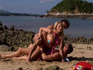 Blonde become man gets laid by the beach with two horny men