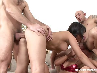 Bitches are being unchanging fucked in a wild foursome