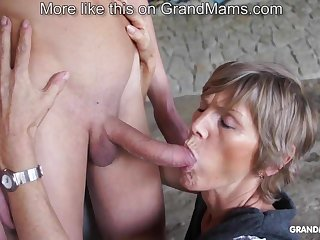 Horny old cougar tapes up her young toyboy plus sucks him off